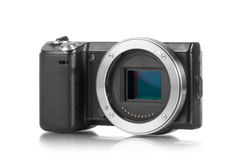 Mirrorless camera without lens. Mirrorless photo camera without lens and sensor bay opened royalty free stock photo