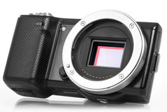 Mirrorless camera without lens. Mirrorless photo camera without lens and sensor bay opened stock photos