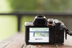 Mirrorless camera white and black color on a old wooden Board Royalty Free Stock Photography