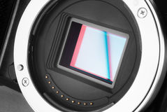 Mirrorless camera sensor. Mirrorless photo camera without lens and sensor bay opened royalty free stock photography