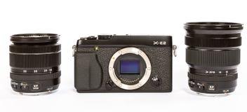 Mirrorless kamera för FUJIFILM X-E2 med FUJINON LENS XF18-55mm F2 8-4 OCH 10-24mm F4 Arkivfoto