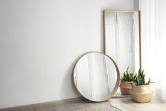 Free Mirrors And Potted Plant Near Window In Room Stock Photo - 165663830