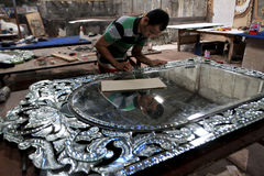 Mirrors. Craftsmen were making decorative mirrors in Sukoharjo, Central Java, Indonesia Royalty Free Stock Image