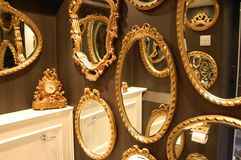 Mirrors. Gold framed mirrors in a loo royalty free stock photos