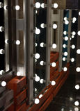 Mirrors with lamps. Royalty Free Stock Image