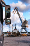 Mirrors truck cranes on the background sea port Royalty Free Stock Image