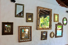 Mirrors. Wall  decorated with different designs, GOA Stock Image