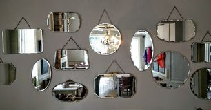 Mirrors on a wall Stock Photos