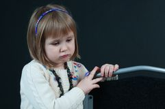 Mirthless girl on the dark background Royalty Free Stock Images