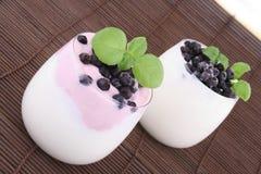 Mirtilli in yogurt Fotografie Stock