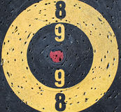 Misaligned target center. Conceptual image of a Target with  a misaligned red center Stock Photo