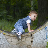 Misbehave. Boy in a garden Stock Images