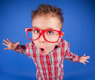 Misbehave concept. Funny five years old boy with expressive face Royalty Free Stock Photo