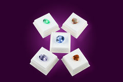 Misc. Colored Gem Stones in White Boxes. Various colors of faceted gem stones, in white boxes, with clipping path Royalty Free Stock Images