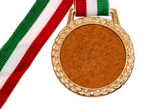 Misc.: Shiny Gold Medal with Red White & Green Ribbon Royalty Free Stock Photography