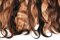 Miscela dei capelli naturali di estensioni: biondo, rosso, marrone Fili dell'ha fotografie stock libere da diritti