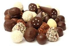 Miscela dei dolci delle caramelle di cioccolato isolati su bianco Fotografia Stock