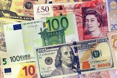 Miscela delle banconote di valute - dollaro, sterlina, euro Immagini Stock