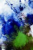 Miscelazione dei colori differenti delle pitture su un Libro Bianco Immagine Stock