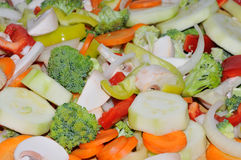 Miscellaneous fresh vegetables. Cut up in pieces ready for stir fry or saute. It includes carrots, broccoli, onions, asparagus, squash, and red and green pepper Stock Photo
