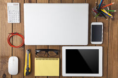 Miscellaneous office material on wood backgound Royalty Free Stock Image