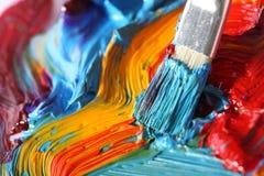 Mischölfarbe mit Malerpinsel Stockbild