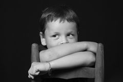 Mischeivious Looking Young Boy. Portrait of a young boy stock photos