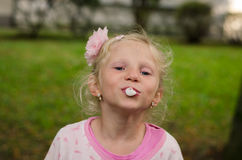 Mischief child blowing chewing gum bubbles Stock Photography
