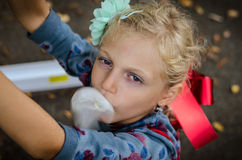 Mischief child blowing chewing gum bubbles Stock Images