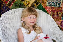 Mischief girl in chair Royalty Free Stock Image