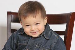 Mischievious Smile. A little boy with a mishievious smile royalty free stock image