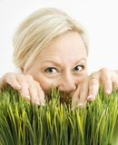 Mischievious woman in grass Royalty Free Stock Image