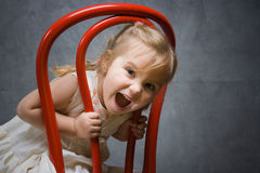 Mischievous baby. Little girl pretends happy mug Royalty Free Stock Photos