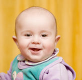 A mischievous baby. Portrait of a pretty small mischievous baby Royalty Free Stock Image