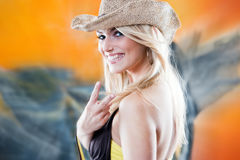 Mischievous beautiful woman making a V-sign Royalty Free Stock Images