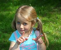 Mischievous blonde girl in the Park. Do you think what I do Royalty Free Stock Image
