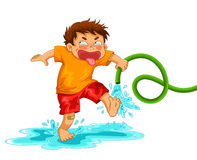 Mischievous boy. Little mischievous boy playing with the water hose Stock Photography