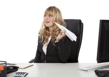 Mischievous businesswoman with a paper plane Royalty Free Stock Images