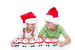 Mischievous christmas kids Royalty Free Stock Photos