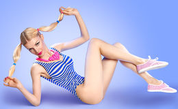 Mischievous fitness blond woman in swimsuit and Royalty Free Stock Image