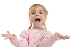 Mischievous girl. The little girl in pink laughs Royalty Free Stock Images