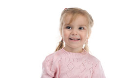 Mischievous girl. The little girl in a pink jersey Royalty Free Stock Image