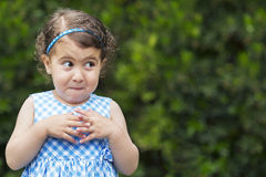 Mischievous girl expression Royalty Free Stock Photo