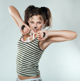 Mischievous girl painted like a cat. Stock Photo