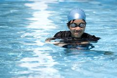 Mischievous Girl in Pool. Image of a teenager swimming in a pool Royalty Free Stock Image