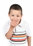 Mischievous kid. A small boy with mischievous grin Stock Photos