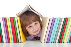 Mischievous kid with freckles and books. Playing - back to school concepty Royalty Free Stock Image