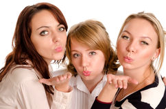Mischievous ladies blowing kisses Stock Photos