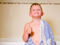 Mischievous little boy in his bath Royalty Free Stock Photo
