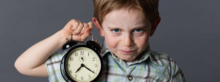 Mischievous little child with red hair alerting about preschooler time Stock Photos